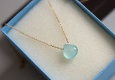 Sweet aquamarine pendant -- March's birthstone and our stowaway's expected debut =)