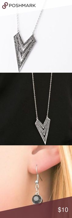 Pointed necklace Encrusted in glittery hematite rhinestones, three flat silvers bars descend into striking angled frames. Enhanced with an elongated silver chain, the large geometric pendant swings from the bottom in an edgy fashion. Perfect for sweater season! Jewelry Necklaces