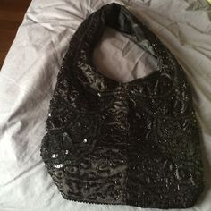 Sequins Handbag. Never used! Cute cloth handbag with all over sequins work. Zip too closure. Bags