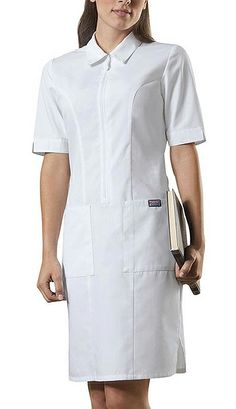 Get a professional look with this white nursing dress from Cherokee Workwear collection. It is created in modern style added with zip front closure with collar and short set-in sleeves. Spa Uniform, Scrubs Uniform, Uniform Dress, Cherokee Uniforms, White Scrubs, Zip Front Dress, Medical Uniforms, Modeling, Blouse Designs