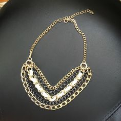 30% off bundles! Cache Multi-metallic necklace Cache Multi-metallic necklace.  Gold & graphite.  Excellent condition. Check out my closet for more great deals,. Cache Jewelry Necklaces