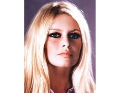 """And God Created Woman  The 1956 film that launched Brigitte Bardot to stardom and defined the term """"sex kitten"""" may be solely responsible for my lifelong loyalty to eyeliner. The actress' voluminous waves, cat eyeliner, and pale pink pout spawned generations of imitators, my adoring self included."""