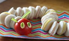 These cute little sandwiches are lined up to look just like the Very Hungry Caterpillar from Eric Carle's much-loved children's book. Pop them onto your party table and your mini guests will snap them up!