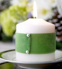 For a festive St. Patrick's Day look, wrap basic candles in green ribbon.