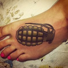 Grenade tattoo on the foot.