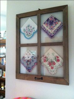 Old hankies in window frame. This would also be cute with crocheted doilies.