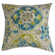 Cotton throw pillow with a floral medallion motif.   Product: PillowConstruction Material: Cotton cover and 95/5 down fillColor: MultiFeatures:  Insert includedHidden zipper closureMade in the USA Dimensions: 18 x 18Cleaning and Care: Spot clean