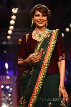 Bollywood beauties Sonam Kapoor and Bipasha Basu walked the ramp for the grand finale of the India International Jewellery Week (IIJW) 2014 in Mumbai on Thursday (July Indian Dresses, Indian Outfits, Pakistani Dresses, Velvet Saree, Saree Blouse Designs, Blouse Patterns, Dress Designs, Indian Couture, Sonam Kapoor