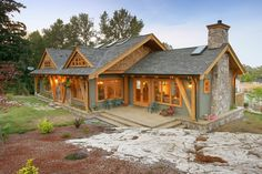 The extensive exterior stonework blends seamlessly with the surrounding rock outcropping; a beautiful home in a beautiful setting. Farm Projects, Home Projects, Custom Home Builders, Custom Homes, Luxury Homes, Beautiful Homes, Floor Plans, Farmhouse, Victoria