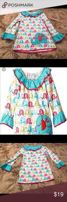 Rare Editions Bashful Elephant Tunic top Rare Editions Bashful Elephant Corduroy Tunic Top  Size 6  Large teal elephant patch  Pink Pom Pom Fringe  Ruffle neck and sleeves 100% Cotton Rare Editions Shirts & Tops