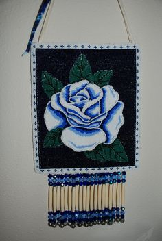 Native American beaded purse by Lynnette Duenas. Rose design