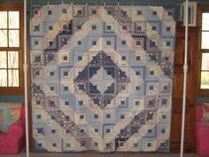 "Log Cabin Quilt, @78""x78"" in the Barn Raising Pattern. This is hand pieced onto a foundation and hand quilted. It is in good condition, although the binding is fraying, and some of the rectangles have frayed.  It has been dated @1945."