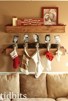 I need something like this since I don't have a mantle. Stocking Holders (little logs and photos). Cute.