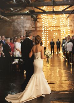 Everything in the picture is perfect, the lights in the barn are such a cool idea and really add a cute touch, her dress also looks PERFECT!!