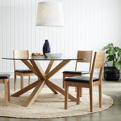 todd dining - I like the raffia rug underneath and I really like the wall cladding for a beach effect that makes the space really smart as well.