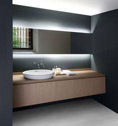 Lighting is so important, especially in minimalistic rooms like this bathroom.