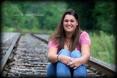 Senior portrait on railroad tracks. Capture the Moment Photography