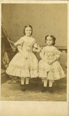 1861, two young girls, very adult clothing and hair style for such young children