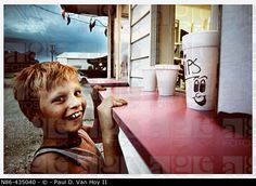 Smiling boy at ice cream stand. Indiana, USA