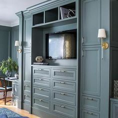 Gray Built In Bedroom Cabinets with TV