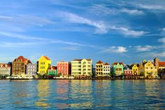 Curacao - I loved the beautiful colors of the Island.  Legend has it that the King had migraines, and the color white triggered them.  He mandated everyone paint their building and the headaches stopped.