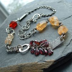 colors, wirework - Necklace Sterling silver Short Red and gold Gemstone Wire Wrapped Mixed. $260.00, via Etsy.
