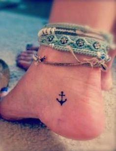 Tiny anchor tattoo on ankle