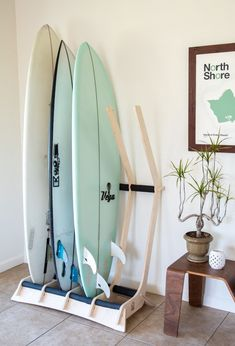 Surfboard racks support our beloved surfboards so they deserve to be awesome. Here are 12 of the coolest surfboard racks we've ever seen. Surfboard Wall Rack, Surfboard Storage, Surfboard Decor, Wooden Surfboard, Decoration Surf, Surf Decor, Deco Surf, Surf Bedroom, Surf Nursery