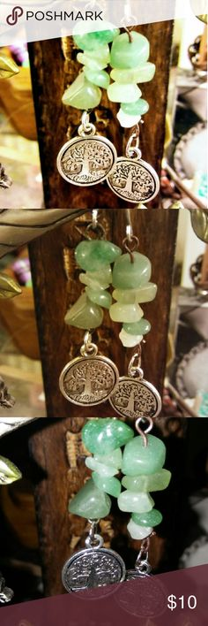 Beautiful aventurine family tree earings Gorgeous light green aventurine Stone silver dangles. with the family tree silver plated charm on the bottom. gorgeous Stone Jade in color, sea green, as well as light seafoam green absolutely stunning colors. the light reflecting of them u can see the little crystals in the Stone. has very many healing properties and is also said to be stress reliever .gorgeous earrings Jewelry Earrings