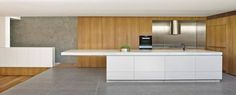 Beautiful minimalist kitchen opening into private courtyard in the Birchgrove by Nobbs Radford Architects. I love the stainless steel cooking zone against the beauty of the natural timber and raw concrete. A winner! #birchgrove #nobbsradfordarchitects #kitchendesign #sydney #interiordesign #stainlesssteel #concretebench #indooroutdoorliving