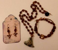 """""""Heart of Agyrtria"""" set featuring Czech glass on hand-knotted cord, vintage button and hand-made puffy ceramic heart pendant"""