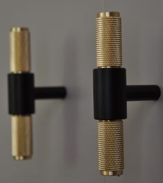 These stunning black and brass handles are from Buster and Punch