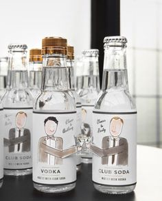 As her gift, Darcy reinterpreted the pair's favorite drink, a vodka-soda, to give as favors. The to-go bottles were decorated with her drawings of the grooms, with their arms cut out so their likenesses could clink glasses.