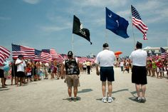 Patriots line the Public Beach Access at Main Street in North Myrtle Beach Wednesday to Salute from the Shore as f-16 Vipers, flown by the 79th Fighter Squadron