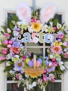 Easter wreath. Love the bunny ears!