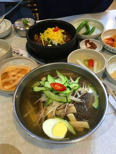 Quieted away, around the corner from one of South Korea's grandest hotels is a great food secret: Gwanghwamun Jip. Its worn-out blue sign gives away the restaurant's long history, and with one spicy spoonful of the signature kimchi stew, it's clear why droves of locals queue up here at lunchtime.