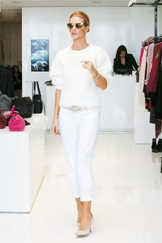Rosie Huntington-Whiteley stuns in all-white with a fuzzy crew neck sweater, white cuffed jeans, and nude heels