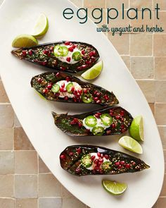 """Tender, golden-brown eggplant are dressed in a mix of herbs and spices, plus a cooling yogurt sauce. The recipe comes from """"Martha Stewart's Cooking School."""""""