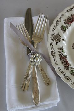 Southern Vintage rental china, purple stemware, napkins, and silver flatware great colors for a fall wedding