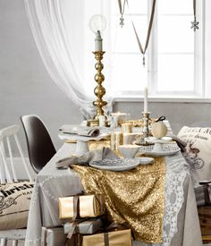 Layered tablecloths: gray linen, lace, sequin