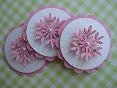 card making ideas ... Pink Snowflake Embellishments ... layered ... scalloped circle punch ... circle punch ... Martha Stewart snowflake punch ... a pearl ... some gems ... sweet  and delicate look ...