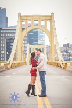 Engagement shoot on the Roberto Clemente Bridge right next to PNC Park. Shot by Man Nguyen Photography, a Pittsburgh wedding photographer, www.mannguyen.com