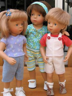 ....Some of Sylvia Natterer dolls.  The brunette haired girl is from Gotz, Germany and the two blond smaller kids are from White Balloon.