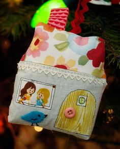 house ornament with fussy-cut  door and window - cute!