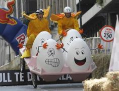 Competitors ride a home-made vehicle without an engine on a 400 metre track during the Red Bull Soapbox Race in Buenos Aires