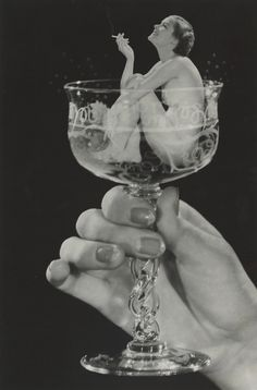 Howard S. Redell - Woman in Champagne Glass (c. 1930) We love Champagne: www.the-champagne.ch Zürcher-Gehrig AG Switzerland @ZGAChampagne	 www.facebook.com/pages/Zurcher-Gehrig-AG