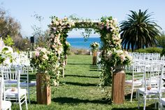 This beachy outdoor wedding called for pastel garden roses, dahlias and hydrangea, finished with lots of overgrown greenery! (Design by Hidden Garden Flowers, Photo by Mi Belle Photographers)