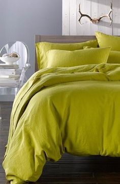 Add a pop of color to a whitewash bedroom.