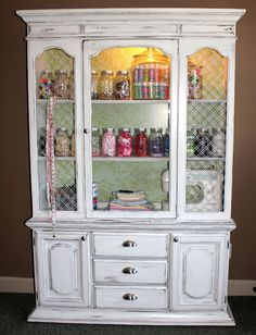 Turning an old wood china cabinet into a gorgeous white shabby chic craft storage.