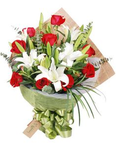 Red roses 9 stems, white lilies 3 stems, match green. English news paper and with gauze packed, finished with bowknot.
